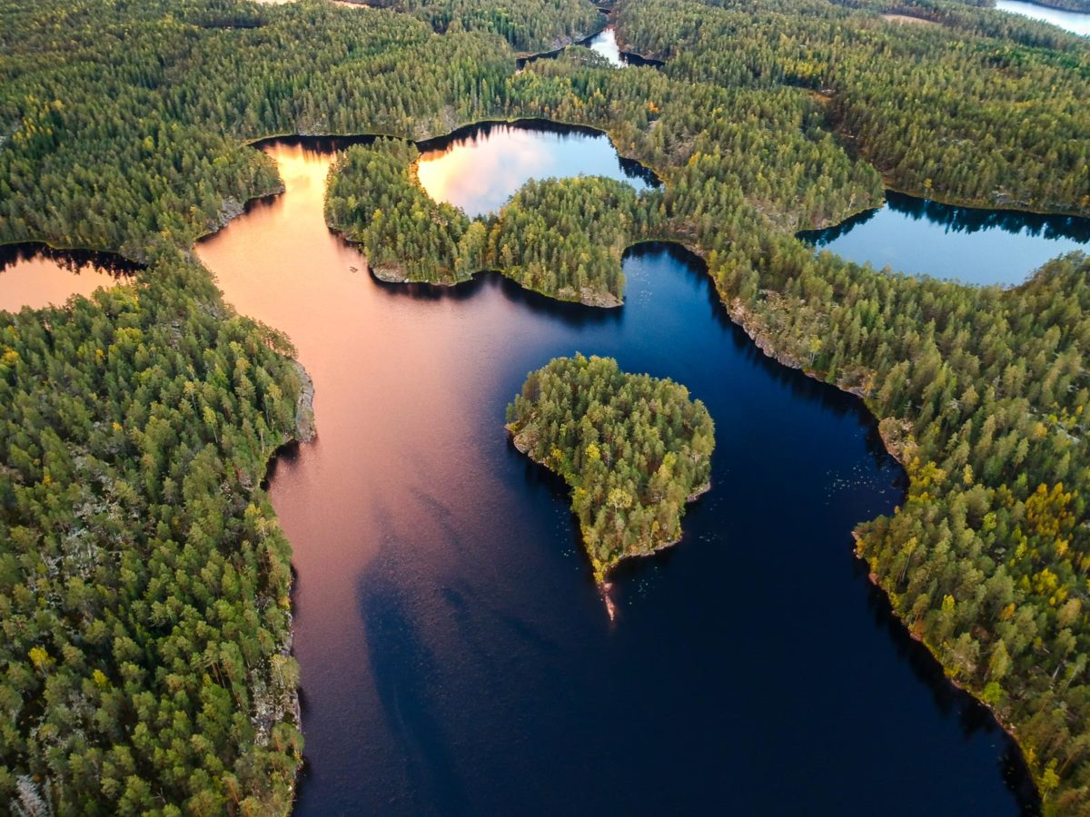Nuuksio National Park in fall in September. Aerial photo of lakes and forest. Nature near Helsinki, Finland.