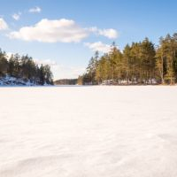 Nuuksio National Park in winter. Lakes are still frozen and there's lot's of snow, but the days are getting longer and warmer at the end of March. Nature near Helsinki, Finland.